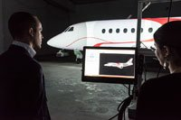Dassault Falcon Jet, Little Rock facility. View of the 3D model of aircraft paint scheme and the video projection of paint scheme on aircraft.